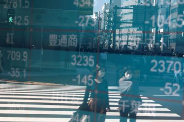 Asian shares grind higher, virus risks block the way